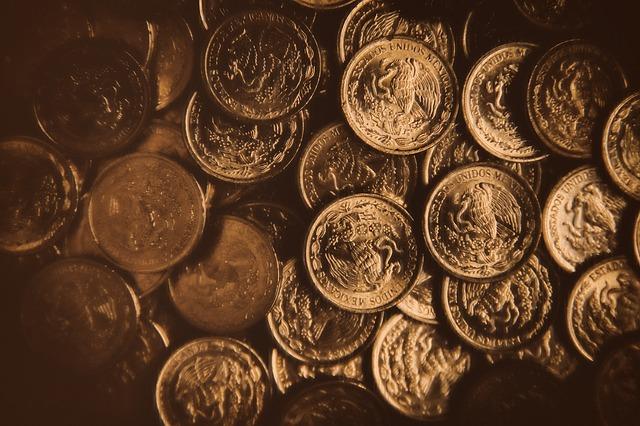 zlaté mince s orlicí